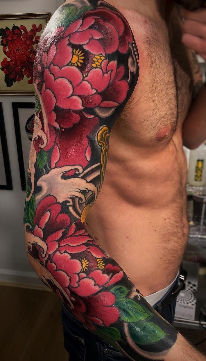 Tatuagem-de-braço-fechado-1