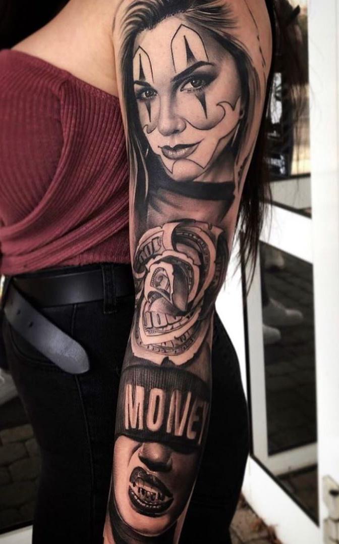 braço-de-mulher-fechado-de-tatuagem