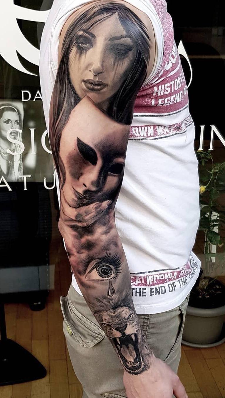 braços-masculinos-fechados-de-tatuagens