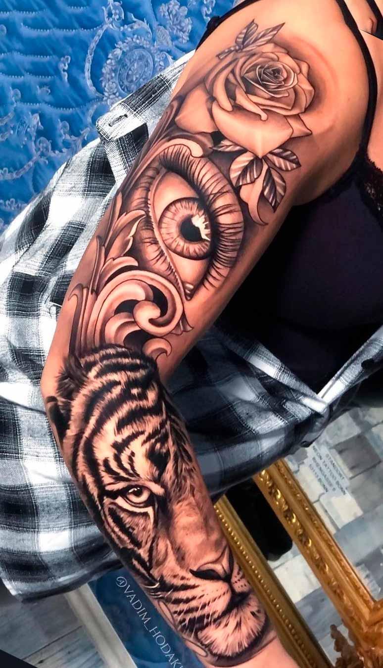 braco-fechado-de-tatuagem-de-olho-e-tigre