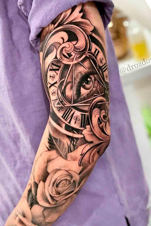 braco-fechado-de-tatuagem-de-relogio-e-rosas