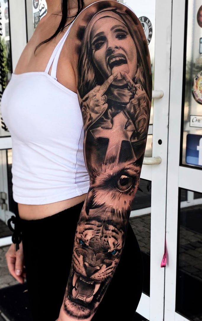 braco-fechado-de-tatuagens-de-cruz-tigre-e-aguia