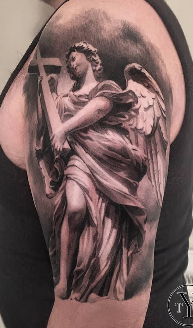 tatuagens-masculina-na-parte-superior-do-braço-8