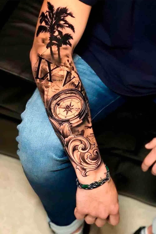 tatuagem-masculina-de-bussola-e-coqueiro
