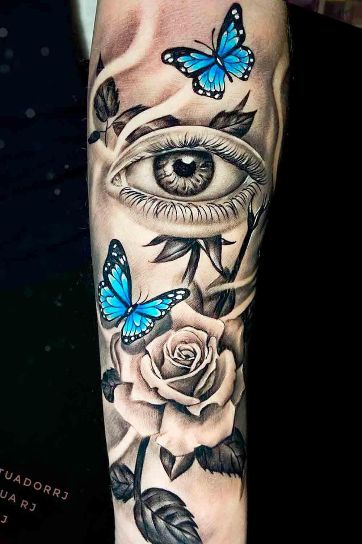 tatuagem-feminina-no-antebraco-de-olho-rosa-e-borboletas