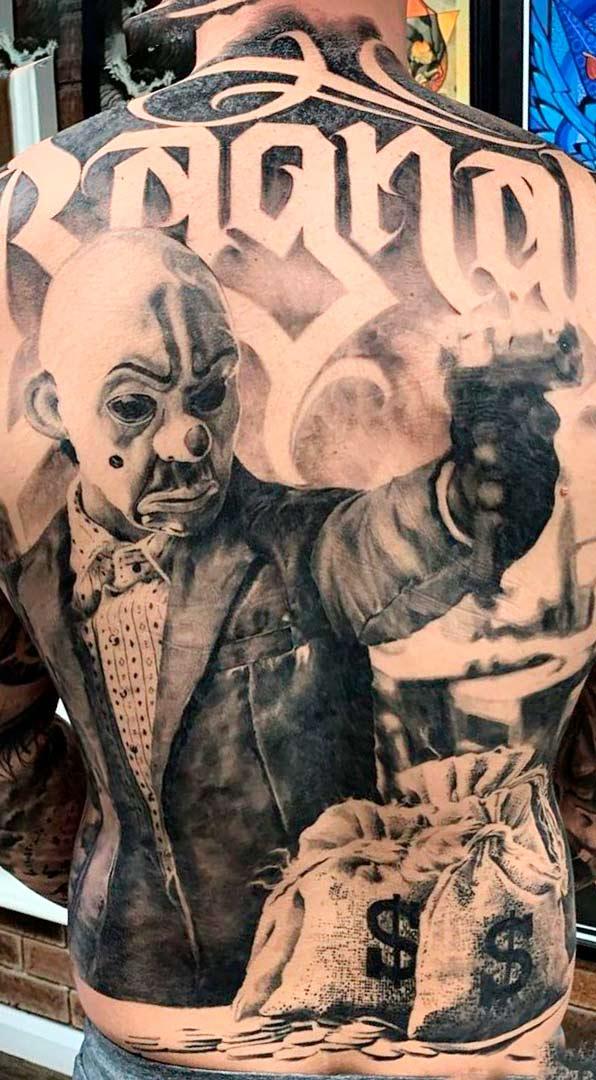 tatuagem-de-palhaco-armado-nas-costas